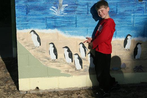 Callum Hartmann pointing out his artistic penguin